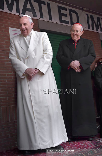 Pope Francis Cardinal Agostino Vallini during his pastoral visit to the parish of St. Joseph in all'Aurelio Rome.December 14, 2014