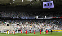 23rd May 2020, BORUSSIA-PARK, North Rhine-Westphalia, Germany; Bundesliga football, Borussia Moenchengladbach versus Bayer Leverkusen; Cardboard pictures of fans placed in the stands to support their teams and a sign to the players as they pay a one-minute silence for the victims of Covid-19 pandemic