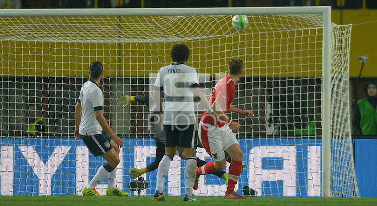 VIENNA, Austria - November 19, 2013: Goalie Tim Howard of USA and Marc Janko of Austria during the international friendly match between Austria and the USA at Ernst-Happel-Stadium.