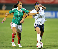 Sydney Leroux (2) of the USWNT goes against Bianca Sierra (3) of Mexico. The USWNT defeated Mexico 7-0 during an international friendly, at RFK Stadium, Tuesday September 3 , 2013.