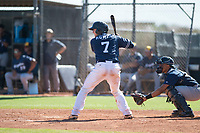 San Diego Padres catcher Jonny Homza (7) at bat in front of catcher Luis Avalo (97) during an Instructional League game against the Milwaukee Brewers at Peoria Sports Complex on September 21, 2018 in Peoria, Arizona. (Zachary Lucy/Four Seam Images)