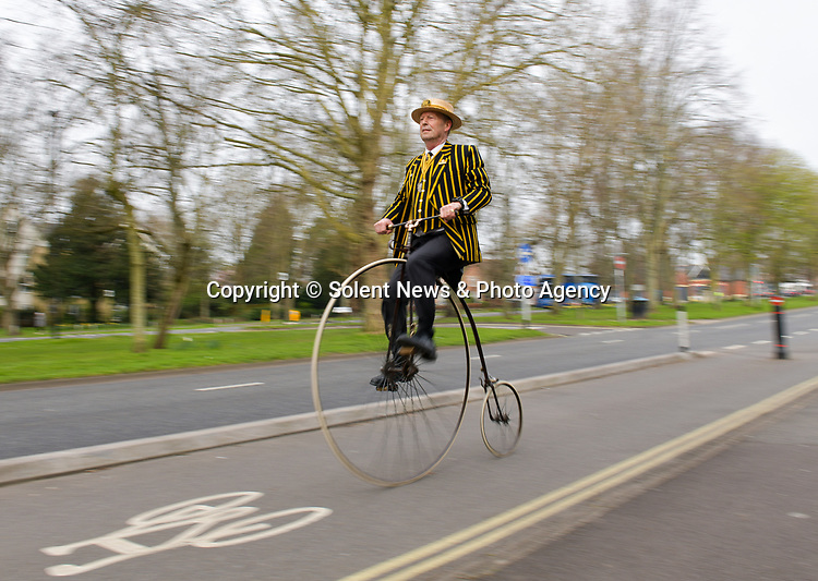 Pictured: Stuart Mason-Elliott, also known as Mr Samuel Pickwick as President of the oldest cycling club in the world The Pickwick Bicycle Club, rides his original 1872 Coventry Machinist Company penny farthing wearing the traditional club uniform on the cycle lane at The Avenue in Southampton, Hants.<br />  <br /> Stuart rides a 22 kilogram, iron frame penny farthing which is believed to be one of the first bicycles ever made. The wheel diameter is 48 inches, with each bicycle being specially tailored to the leg length of the rider.<br />  <br /> Stuart was elected president of The Pickwick Bicycle Club, formed in 1870  for the second consecutive year, due to Covid-19 restrictions on club activities. Members wear the traditional club uniform of a yellow and black striped blazer, waistcoat with a straw boater hat and are also assigned a sobriquet of a character from The Pickwick Papers, which they represent. <br /> <br /> © Jordan Pettitt/Solent News & Photo Agency<br /> UK +44 (0) 2380 458800