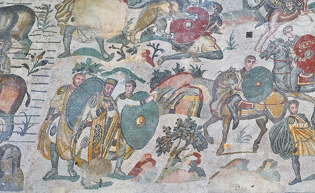 Ambulatory of the Great Hunt Roman mosaic, Emperor Maximianus watches the animal hunt, room no 28, at the Villa Romana del Casale, first quarter of the 4th century AD. Sicily, Italy. A UNESCO World Heritage Site.<br /> <br /> The Great Hunt ambulatory is around 60 meters long (200 Roman feet) and connects the master's northern apartments with the triclinium in the south. The door in the centre of the the Great Hunt ambulatory leads to audience hall. <br /> <br /> The Great Hunt Roman mosaic depicts African animals being hunted and put onto ships to be taken to the Colosseum.