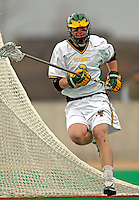 10 April 2007: University of Vermont Catamounts' John Leonard, a Senior from Woolwich, ME, in action against the Holy Cross Crusaders at Moulton Winder Field, in Burlington, Vermont. The Crusaders rallied to defeat the Catamounts 5-4...Mandatory Photo Credit: Ed Wolfstein Photo