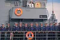 Saint Petersburg, Russia, 28/07/2002..Sailors shout out the salute to passing admirals reviewing the fleet during Russian Navy Day. Peter the Great founded the Russian Navy, and St Petersburg remains the home of the fleet. Navy Day brings the ships tp port and the sailors to shore.......