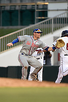 St. Lucie Mets first baseman Matt Oberste (5) stretches for a throw as Jason Kanzler (8) runs through the bag during a game against the Fort Myers Miracle on April 19, 2015 at Hammond Stadium in Fort Myers, Florida.  Fort Myers defeated St. Lucie 3-2 in eleven innings.  (Mike Janes/Four Seam Images)