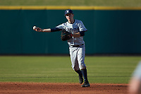 Chris Givin (35) of the Xavier Musketeers makes a throw to first base against the Penn State Nittany Lions at Coleman Field at the USA Baseball National Training Center on February 25, 2017 in Cary, North Carolina. The Musketeers defeated the Nittany Lions 7-5 in game two of a double header. (Brian Westerholt/Four Seam Images)