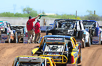Apr 16, 2011; Surprise, AZ USA; LOORRS officials check with drivers on the grid during round 3 at Speedworld Off Road Park. Mandatory Credit: Mark J. Rebilas-