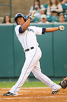 Ramon Morla #22 of the Pulaski Mariners follows through on his swing against the Greeneville Astros at Calfee Park August 29, 2010, in Pulaski, Virginia.  Photo by Brian Westerholt / Four Seam Images