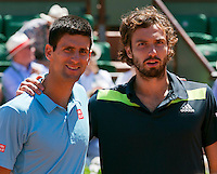 France, Paris, 04.06.2014. Tennis, French Open, Roland Garros, Novak Djokovic (SRB) and his opponent Ernests Gulbis (LAT) (R)<br /> Photo:Tennisimages/Henk Koster