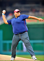 """21 June 2011: University of Arizona Junior Daniel Hernandez throws out the ceremonial first pitch prior to a game between the Seattle Mariners and the Washington Nationals at Nationals Park in Washington, District of Columbia. Hernandez had been U.S. Rep. Gabrielle Giffords' intern for five days when she was shot outside Tucson. He was helping check people in at the """"Congress on Your Corner"""" event when he heard gunfire and came to Giffords' aid. Hernandez watched the game as the Nationals rallied from a 5-1 deficit, scoring 5 runs in the bottom of the 9th, to defeat the Mariners 6-5 in inter-league play. Mandatory Credit: Ed Wolfstein Photo"""