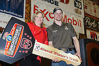 Anchorage Chrysler Dodge sponsor hads the keys to a new dodge pickup to 2015 Iditarod champion Dallas Seavey  at the finishers banquet in Nome on Sunday  March 22, 2015 during Iditarod 2015.  <br /> <br /> (C) Jeff Schultz/SchultzPhoto.com - ALL RIGHTS RESERVED<br />  DUPLICATION  PROHIBITED  WITHOUT  PERMISSION