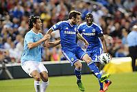 Juan Mata (10) Chelsea watched by Manchester City defender Karim Rekik..Manchester City defeated Chelsea 4-3 in an international friendly at Busch Stadium, St Louis, Missouri.