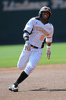 Khayyan Norfork #8 of the Tennessee Volunteers runs runs to third to complete a triple at Lindsey Nelson Stadium against the the Manhattan Jaspers on March 12, 2011 in Knoxville, Tennessee.  Tennessee won the first game of the double header 11-5.  Photo by Tony Farlow / Four Seam Images..