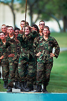 Male recruits on a confidence training course at Lackland Air Force Base. San Antonio, Texas.