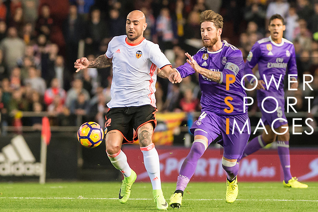 Sergio Ramos (r) of Real Madrid competes for the ball with Simone Zaza of Valencia CF during their La Liga match between Valencia CF and Real Madrid at the Estadio de Mestalla on 22 February 2017 in Valencia, Spain. Photo by Maria Jose Segovia Carmona / Power Sport Images