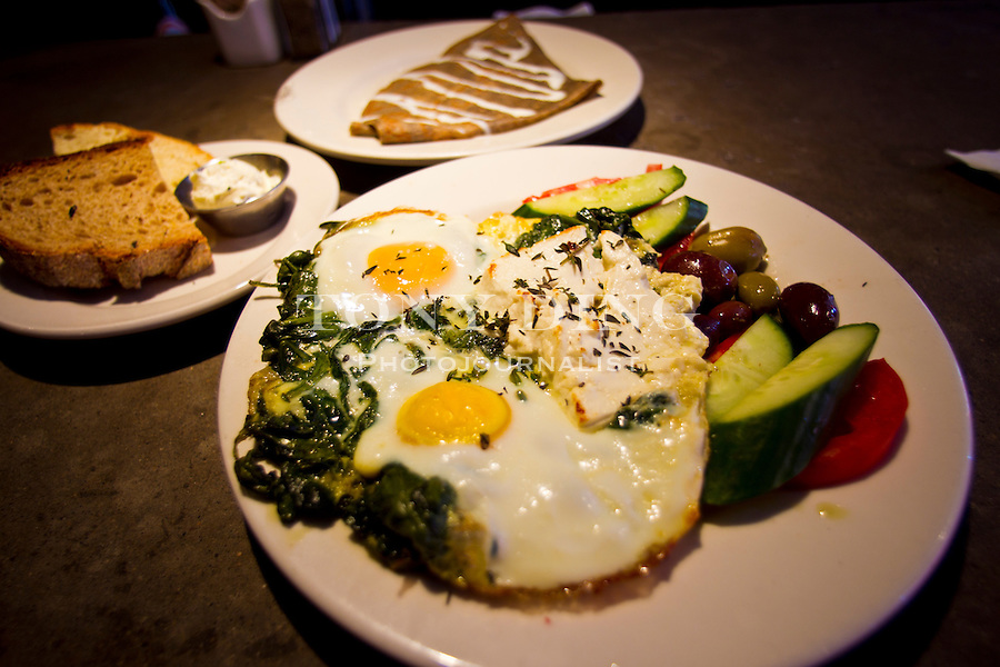 Café Zola's Turkish Eggs ($12.95) and side of crêpes with fresh herb butter ($8.95), Friday, Sept. 2, 2011 in Ann Arbor, Mich. (Tony Ding for The New York Times)