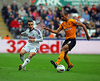 FAO SPORTS PICTURE DESK<br /> Pictured L-R: Leon Britton of Swansea against Karl Henry of Wolves. Saturday, 28 April 2012<br /> Re: Premier League football, Swansea City FC v Wolverhampton Wanderers at the Liberty Stadium, south Wales.