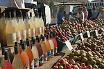 Apples and bottles and organic apple and fruit drinks.  Blackheath Farmers Market. South East London. UK 2008.