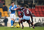 St Johnstone v Stenhousemuir…21.01.17  McDiarmid Park  Scottish Cup<br />Danny Swanson gets between Vincent Berry and<br />Picture by Graeme Hart.<br />Copyright Perthshire Picture Agency<br />Tel: 01738 623350  Mobile: 07990 594431