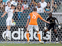 LA Galaxy defender Gregg Berhalter (16) clears a ball out of the box as teammate goalkeeper Donovan Ricketts (1) and Houston Dynamo forward Cam Weaver (15) look on. The LA Galaxy defeated the Houston Dynamo 4-1 at Home Depot Center stadium in Carson, California on Saturday evening June 5, 2010..