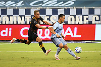 KANSAS CITY, UNITED STATES - AUGUST 25: Roger Espinoza #15 of Sporting Kansas City holds off Darwin Ceren #24 of Houston Dynamo  a game between Houston Dynamo and Sporting Kansas City at Children's Mercy Park on August 25, 2020 in Kansas City, Kansas.