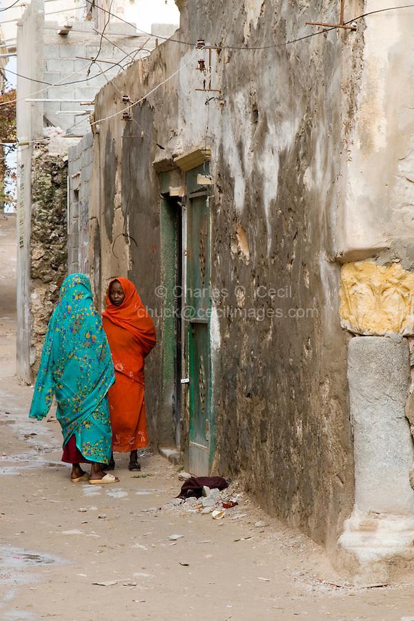 Tripoli, Libya - African Immigrants Talking in Medina Street.  Many sub-Saharan immigrants live in Tripoli's medina.