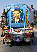 © Piers Benatar/Panos Pictures..Sindh, Pakistan. 2001...Pakistan is very proud of its status as the only Muslim nuclear power, a pride which manifests itself in sculptures, murals and merchandising paraphernalia depicting its Ghauri and Shaheen missiles. Here, a petrol tanker is painted with a portrait of Dr. Ijaz Ghauri, the country's foremost nuclear scientist.