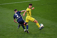 15th March 2020, Wellington, New Zealand;  Phoenix's Liberato Cacace goes past Victory's Storm Roux during the A-League - Wellington Phoenix versus Melbourne Victory football match at Sky Stadium in Wellington on Sunday the 15th March 2020.