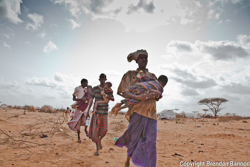 Somali refugees in Dagahaley refugee camp carrying their sick and malnourished children to a new feeding center run by Doctors Without Borders on the outskirts of the sprawling refugee camp in Kenya.