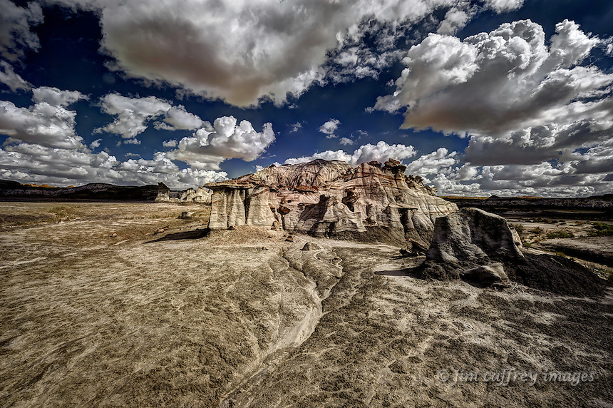 An eroded hillside in Alamo Wash in the Bisti Wilderness of northwest New Mexico showing slowly emerging hoodoos.
