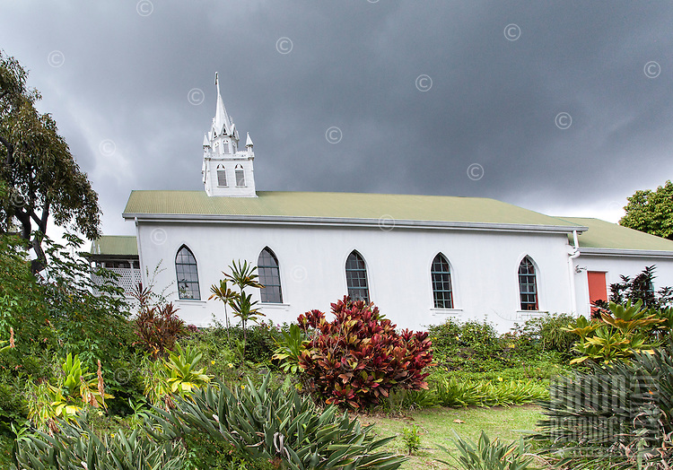 """Outside view of St. Benedict Roman Catholic Church (a.k.a. """"The Painted Church"""") Captain Cook, Big Island."""
