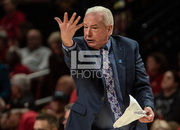 COLLEGE PARK, MD - JANUARY 26: Head coach of Northwestern Joe McKeowne calls out to the referee during a game between Northwestern and Maryland at Xfinity Center on January 26, 2020 in College Park, Maryland.