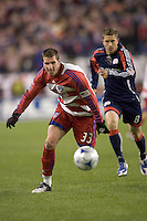 FC Dallas forward Kenny Cooper (33) chases pass as New England Revolution midfielder Chris Tierney (8) defends. The New England Revolution defeated FC Dallas, 2-1, at Gillette Stadium on April 4, 2009. Photo by Andrew Katsampes /isiphotos.com