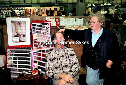 Solihull, Warwickshire. 1991<br /> Two Toy Poodles and their husband and wife owners at the Crufts Centenary dog show, held for the first time outside of London at its new venue, the Birmingham National Exhibition Centre