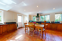 BNPS.co.uk (01202 558833)<br /> Pic: Savills/BNPS<br /> <br /> Pictured: The kitchen.<br /> <br /> A clifftop home with breathtaking panoramic sea views is on the market for £3.25m.<br /> <br /> Sandpierre also has a private swimming pool and a viewing platform overlooking the beach with 180-degree views of the water. <br /> <br /> The six-bedroom family home is on the Bournemouth/Poole coastline in Dorset and is being sold for the first time in 25 years.<br /> <br /> The house was built in the 1930s and is in a quiet cul-de-sac in Branksome Dene Chine - midway between the town centres of Bournemouth and Poole.