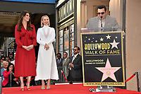 LOS ANGELES, CA. November 19, 2019: Idina Menzel, Kristen Bell & Josh Gad at the Hollywood Walk of Fame Star Ceremony honoring Kristen Bell & Idina Menzel.<br /> Pictures: Paul Smith/Featureflash