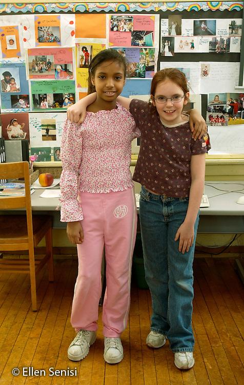 MR / Schenectady, NY.Yates Arts-in-Education Magnet School (urban elementary school) .Grade 4 .Portrait of girls; girl left: 9, Puerto-Rican American and African American; girl right: 10..MR: Fin5   Goo7.©Ellen B. Senisi