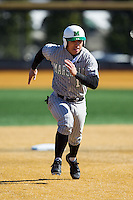 Andrew Dundon (14) of the Marshall Thundering Herd hustles towards third base against the Georgetown Hoyas at Wake Forest Baseball Park on February 15, 2014 in Winston-Salem, North Carolina.  The Thundering Herd defeated the Hoyas 5-1.  (Brian Westerholt/Four Seam Images)