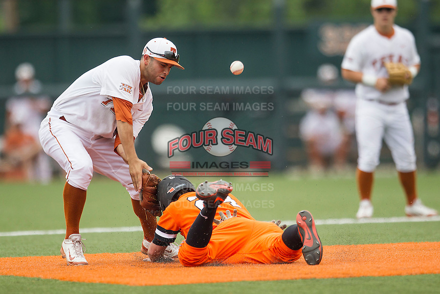Texas Longhorns shortstop CJ Hinojosa #9 bobbles a pickoff throw at second base during the NCAA baseball game against the Oklahoma State Cowboys on April 26, 2014 at UFCU Disch–Falk Field in Austin, Texas. The Cowboys defeated the Longhorns 2-1. (Andrew Woolley/Four Seam Images)