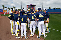 Michigan Wolverines head coach Erik Bakich (23) talks with his team before the second game of a doubleheader against the Canisius College Golden Griffins on February 20, 2016 at Tradition Field in St. Lucie, Florida.  Michigan defeated Canisius 3-0.  (Mike Janes/Four Seam Images)