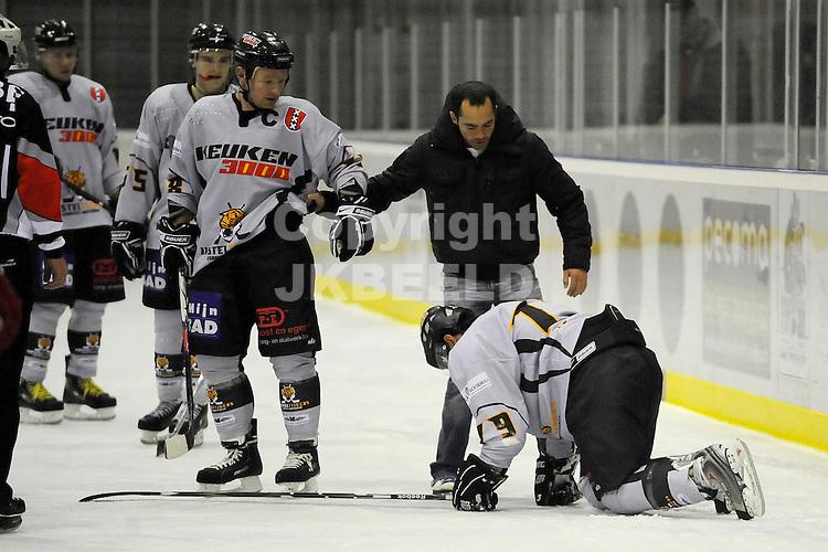 ijshockey grzzlies - amstel tigers seizoen 2008-2009 08-02-2009  blessure bij eric thosmassian.