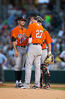 Norfolk Tides starting pitcher Tyler Wilson (34) listens as pitching coach Mike Griffin (27) talks during the game against the Charlotte Knights at BB&T BallPark on April 9, 2015 in Charlotte, North Carolina.  The Knights defeated the Tides 6-3.   (Brian Westerholt/Four Seam Images)