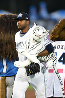 West Michigan Whitecaps pitcher Montreal Robertson (31) carries a stuffed Tiger through the line after a game against the Great Lakes Loons on June 4, 2014 at Fifth Third Ballpark in Comstock Park, Michigan.  West Michigan defeated Great Lakes 4-1.  (Mike Janes/Four Seam Images)