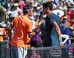 Roger Federer (SUI) and Milos Raonic (CAN) shake hands after their semifinal match. Federer advanced to Sunday's final after defeating Raonic 75 64 at the BNP Parisbas Open in Indian Wells, CA on March 21, 2015.