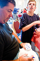 Jerry Jaminet and his son Nicholas at the Share and Care Network's annual retreat held at the Doubletree Guest Suites Hotel in Boston on May 20, 2006. <br /> <br /> The Share and Care Network was created in 1981 by Pat Cahill when her son Scott was diagnosed with Cockayne Syndrome.  A rare form of dwarfism, Cockayne Syndrome is a genetically determined condition whose symptoms include microcephaly, mental retardation, progressive blindness, progressive hearing loss, premature aging, and a shortened lifespan averaging 18 years.  Those afflicted have distinctive facial features, including sunken eyes, pinched faces, and protruding jaws as well as distinctive gregarious, affectionate personalities.<br /> <br /> Because of the rarity of the condition (1/1,000 live births) and its late onset (characteristics usually begin to appear only after one year), many families and physicians are often baffled by children whose health begins to deteriorate after normal development.  It was partly with this in mind that the Share and Care Network was formed, to promote awareness of this disease as well as to provide a support network for those families affected.  In 1998 it began organizing an annual retreat, which has grown from three families in its inaugural year to more than 30 today.  Although the retreat takes place in the United States, families from as far as Japan arrive for this one weekend out of the year to share information and to support one another.
