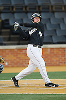 Ben Breazeale (9) of the Wake Forest Demon Deacons follows through on his swing against the Georgetown Hoyas at Wake Forest Baseball Park on February 16, 2014 in Winston-Salem, North Carolina.  The Demon Deacons defeated the Hoyas 3-2.  (Brian Westerholt/Four Seam Images)
