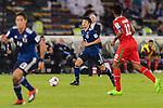 Shibasaki Gaku of Japan (C) runs with the ball during the AFC Asian Cup UAE 2019 Group F match between Oman (OMA) and Japan (JPN) at Zayed Sports City Stadium on 13 January 2019 in Abu Dhabi, United Arab Emirates. Photo by Marcio Rodrigo Machado / Power Sport Images