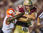Florida State tight end Nick O'Leary, right, drags Clemson corner back Mackensie Alexander to the one yard line in the second half of an NCAA college football game against Clemson in Tallahassee, Fla., Saturday, Sept. 20, 2014.  Florida State defeated Clemson 23-17 in overtime.  (AP Photo/Mark Wallheiser)