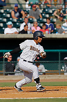 """Charleston Riverdogs catcher Eduardo Navas (17) at bat during a game against the Hickory Crawdads at the Joseph P. Riley Ballpark in Charleston, South Carolina. For Sunday games, the Riverdogs wear their """"Holy City"""" uniforms in honor of the city's nickname. Hickory defeated Charleston 8-7. (Robert Gurganus/Four Seam Images)"""